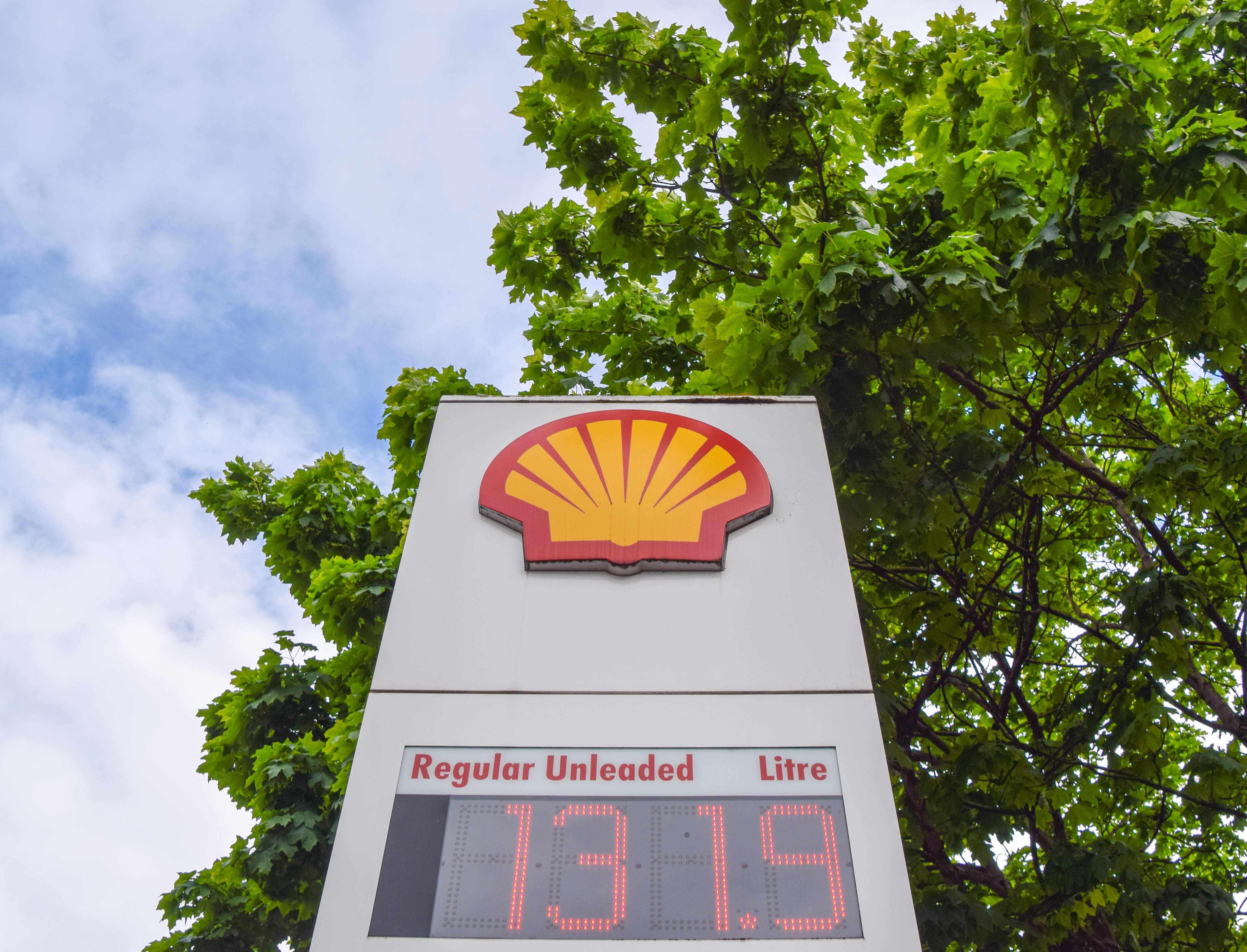 dividend shell oil share buyback