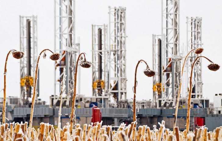 exxon profit oil prices reuters