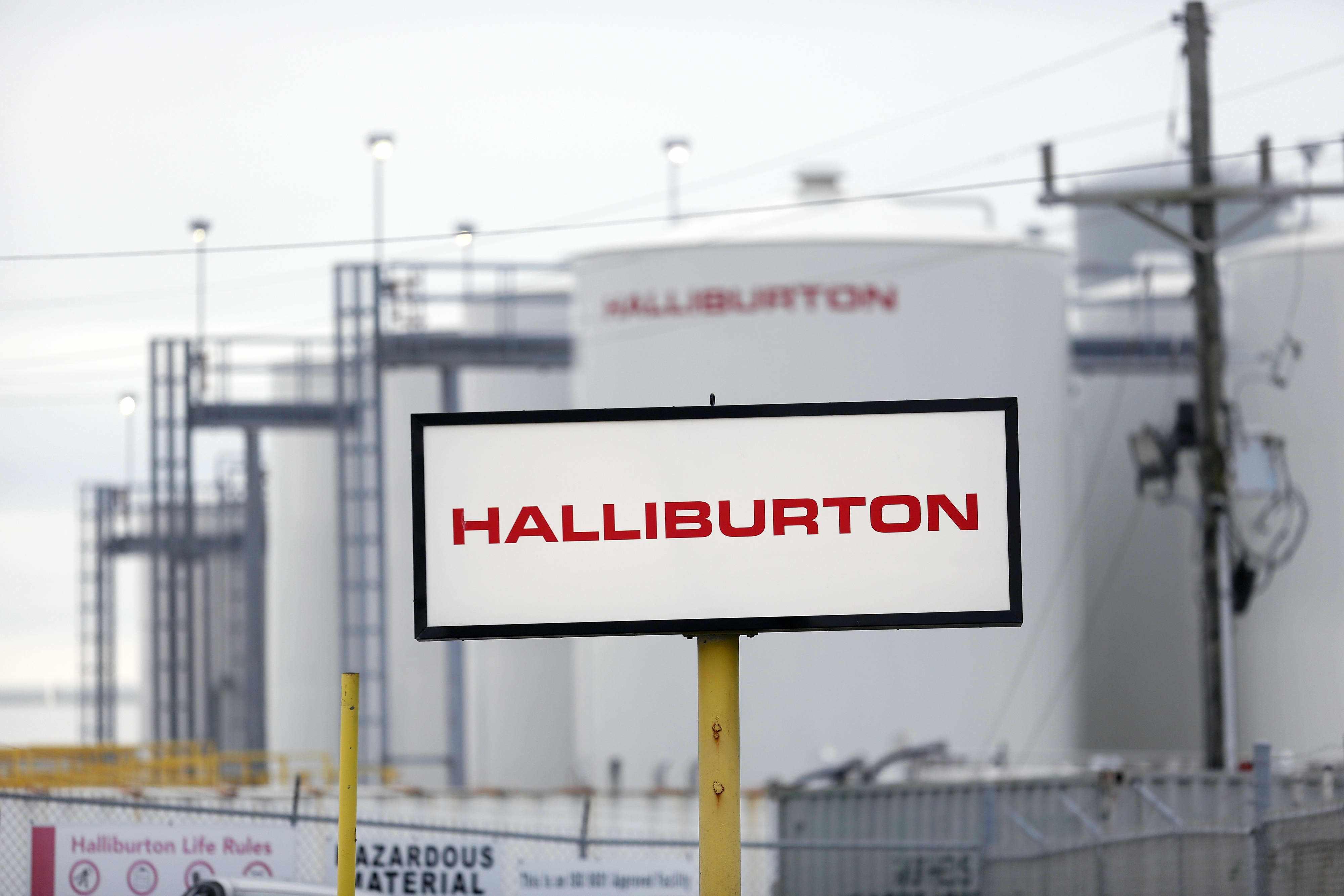 goldman halliburton dividend hike upgrades
