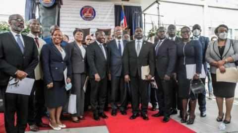 haiti president installs leader slain