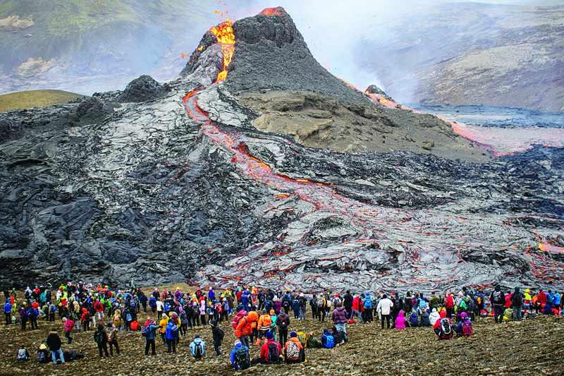 iceland thousands erupting volcano flock