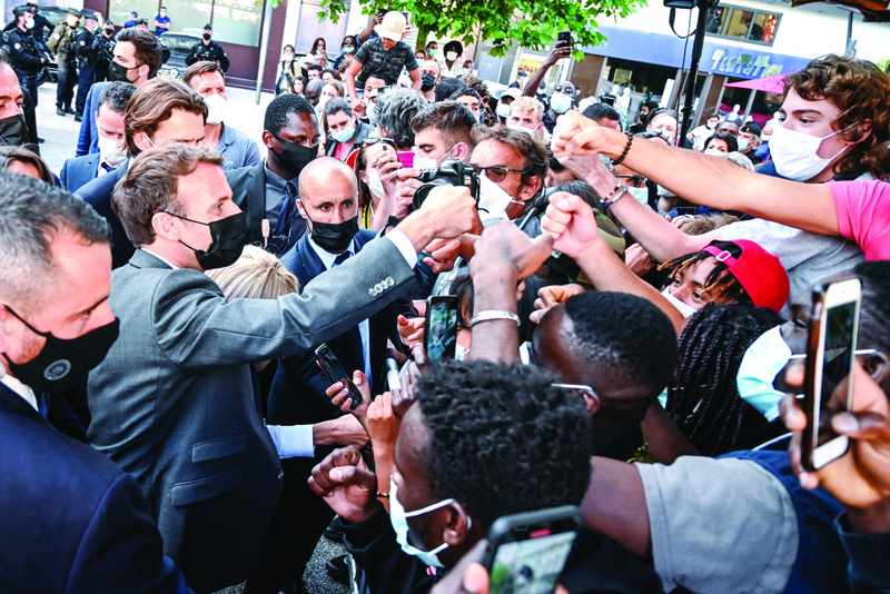 macron french president security defy