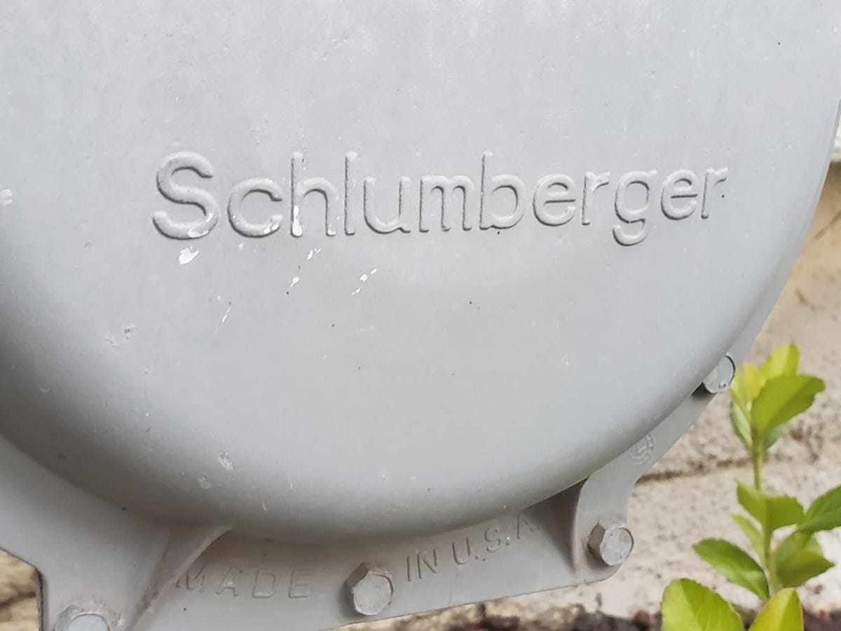 schlumberger upside stock revenue production